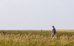Woman on a field Royalty Free Stock Photography