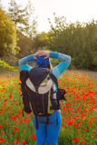Woman in a field of blooming poppies  enjoying life Royalty Free Stock Photo