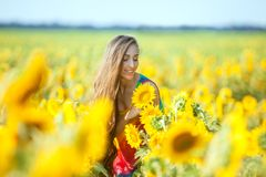 Woman on the field with flowers. Stock Image