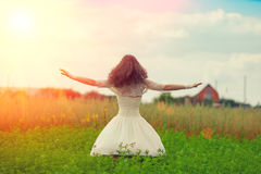 Woman on the field. Happy bride dancing on the field royalty free stock photos