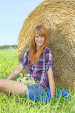 Woman in a field with hay bales Stock Photos