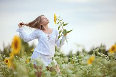 Woman in the field in the morning. Stock Image