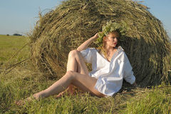 Woman in a field near haystacks Royalty Free Stock Photos