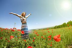 Woman in a field of poppies royalty free stock photo