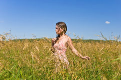 Woman in a field of rye Stock Photography