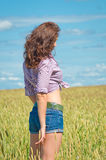 Woman in the field, seen from behind Stock Image