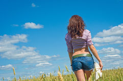 Woman in the field, seen from behind Royalty Free Stock Photos