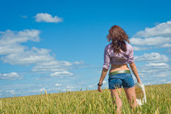 Woman in the field, seen from behind Stock Images