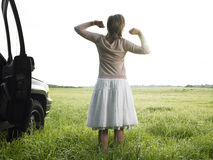 Woman in Field Stretching Royalty Free Stock Image