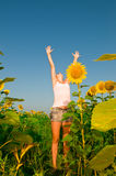Woman on field in summer Stock Image