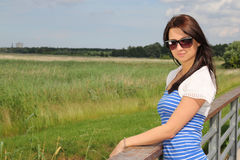 Woman in the field in summer time Stock Image