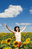 Woman in the field of sunflowers stock image