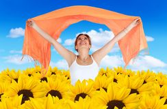 Woman in a field of sunflowers Stock Photo
