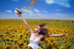 Woman in field with sunflowers Royalty Free Stock Photos