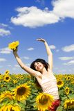 Woman in the field of sunflowers Royalty Free Stock Photo