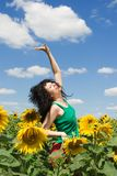 Woman in the field of sunflowers Royalty Free Stock Photography