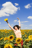 Woman in field of sunflowers Stock Photography