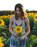 Woman on field with sunflowers