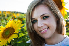 A woman on a field of sunflowers Royalty Free Stock Image