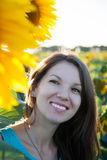 Woman on the field with sunflowers Stock Photography