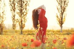Woman in field in sunlight Royalty Free Stock Image