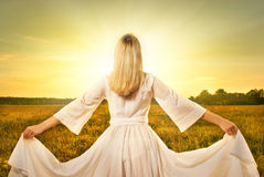 Woman in the field at sunset Royalty Free Stock Image