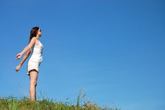 Woman in field under blue sky Royalty Free Stock Images