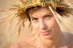 Woman in field of wheat Royalty Free Stock Image