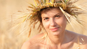 Woman in field of wheat Stock Photography