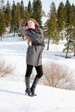 Woman in-field in winter. Young woman in-field in winter Royalty Free Stock Photo