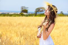 A woman is in the field with a wreath Stock Image