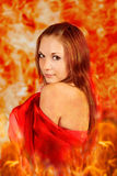 Woman in a fiery flame. Woman in a fiery flame with a tattoo on a shoulder Stock Image
