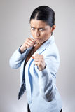 Woman in a fight pose Royalty Free Stock Photography