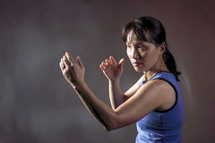 Woman in fight position. Royalty Free Stock Photo