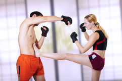 Woman fighter - front kick. self-defense stock image