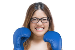 Woman fighting with blue boxing gloves. Woman fighting concept with asian woman wearing blue boxing gloves Stock Photography