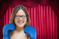 Woman fighting with blue boxing gloves Royalty Free Stock Photography