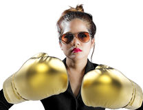 Woman fighting concept with golden boxing gloves Stock Images