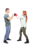 Woman fighting with a man stock photography