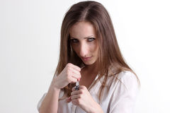 Woman in Fighting Position Isolated on White Background. Sexy Woman in Fight Position and Long Brown Hair Isolated on White Background Stock Photos