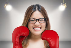 Woman fighting with red boxing gloves Stock Photos