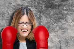 Woman fighting with red boxing gloves Stock Images