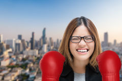 Woman fighting with red boxing gloves Stock Photo