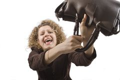 Woman fights with a hand bag Stock Photos