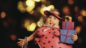 Woman figure shopping bags footage. Studio work stock footage
