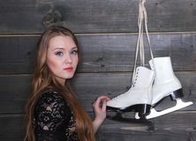 Woman and figure skates Royalty Free Stock Image