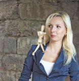 Woman with figurine Royalty Free Stock Image