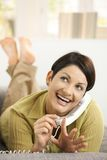 Woman filing nails while chatting Stock Images