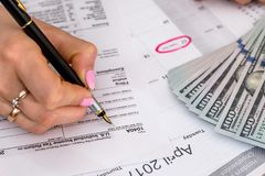 Woman filing US tax form. royalty free stock photos
