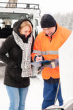 Woman fill document broken car snow mechanic. Woman answering inquiry broken car snow mechanic assistance road winter Stock Images